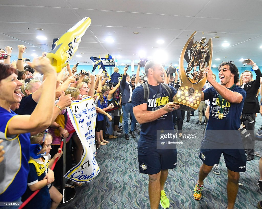 Matthew Scott and Johnathan Thurston of the Cowboys hold the NRL trophy aloft after arriving back at the Townsville airport before heading out to the North Queensland Cowboys NRL Grand Final fan day at 1300 Smiles Stadium on October 5, 2015 in Townsville, Australia.