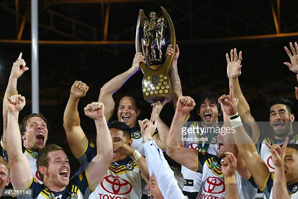 Matthew Scott and Johnathan Thurston of the Cowboys hold the Premiership trophy aloft as the Cowboys celebrate victory during the 2015 NRL Grand...