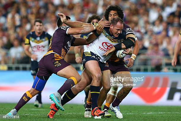 Matthew Scott of the Cowboys is tackled during the 2015 NRL Grand Final match between the Brisbane Broncos and the North Queensland Cowboys at ANZ...