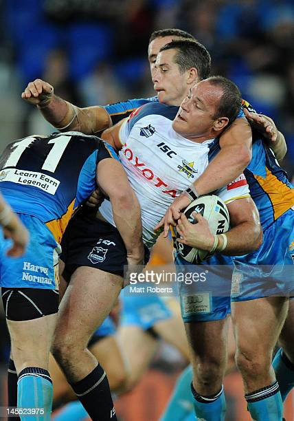 Matthew Scott of the Cowboys is tackled during the round 13 NRL match between the Gold Coast Titans and the North Queensland Cowboys at Skilled Park...