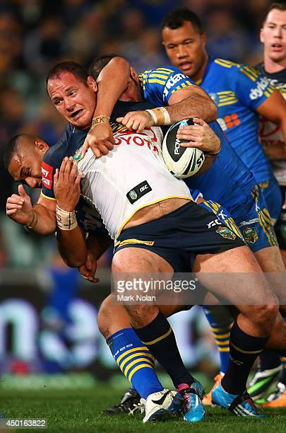 Matthew Scott of the Cowboys is tackled during the round 13 NRL match between the Parramatta Eels and the North Queensland Cowboys at Pirtek Stadium...