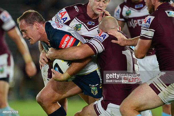 Matthew Scott of the Cowboys is tackled during the round seven NRL match between the ManlyWarringah Sea Eagles and the North Queensland Cowboys at...