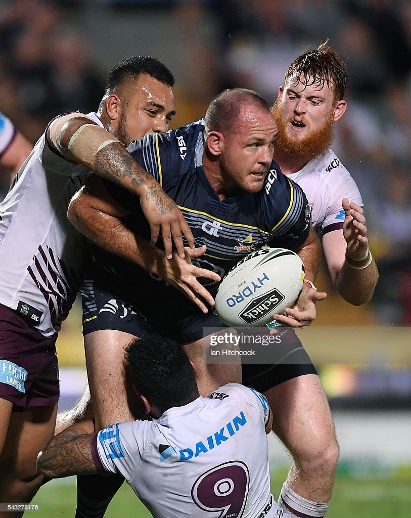 <a gi-track='captionPersonalityLinkClicked' href=/galleries/search?phrase=Matthew+Scott+-+Rugby+League+Player&family=editorial&specificpeople=9847394 ng-click='$event.stopPropagation()'>Matthew Scott</a> of the Cowboys is wrapped up by the Manly defence during the round 16 NRL match between the North Queensland Cowboys and the Manly Sea Eagles at 1300SMILES Stadium on June 27, 2016 in Townsville, Australia.