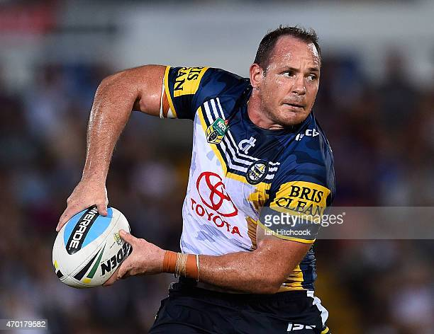 Matthew Scott of the Cowboys looks to pass the ball during the round seven NRL match between the North Queensland Cowboys and the New Zealand...