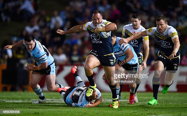 Matthew Scott of the Cowboys makes a break during the Second NRL Semi Final match between the North Queensland Cowboys and the Cronulla Sharks at...
