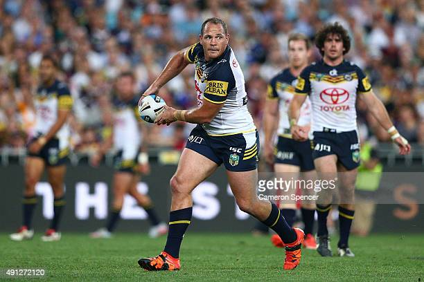 Matthew Scott of the Cowboys offloads the ball during the 2015 NRL Grand Final match between the Brisbane Broncos and the North Queensland Cowboys at...