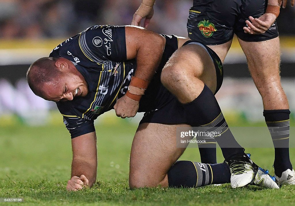 <a gi-track='captionPersonalityLinkClicked' href=/galleries/search?phrase=Matthew+Scott+-+Rugby+League+Player&family=editorial&specificpeople=9847394 ng-click='$event.stopPropagation()'>Matthew Scott</a> of the Cowboys reacts after being injured during the round 16 NRL match between the North Queensland Cowboys and the Manly Sea Eagles at 1300SMILES Stadium on June 27, 2016 in Townsville, Australia.