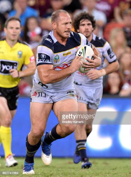 Matthew Scott of the Cowboys runs with the ball during the round two NRL match between the Brisbane Broncos and the North Queensland Cowboys at...