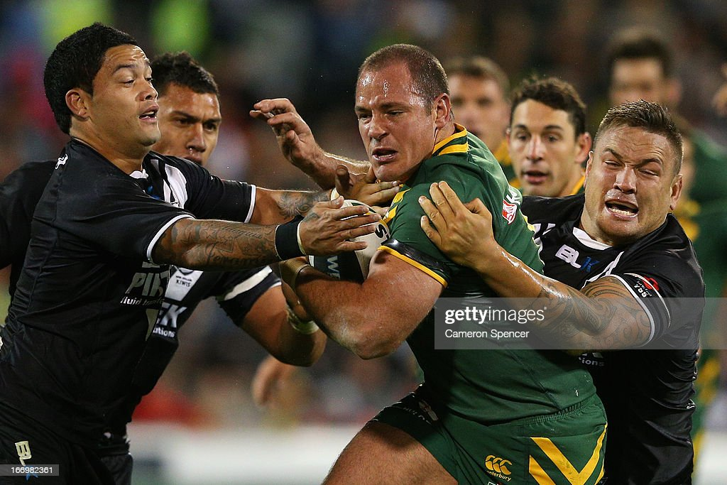 Matthew Scott of the Kangaroos is tackled during the ANZAC Test match between the Australian Kangaroos and the New Zealand Kiwis at Canberra Stadium on April 19, 2013 in Canberra, Australia.