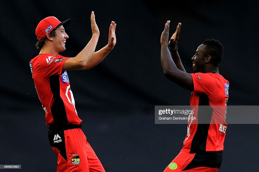 Matthew Short (L) and <a gi-track='captionPersonalityLinkClicked' href=/galleries/search?phrase=Andre+Russell&family=editorial&specificpeople=5348594 ng-click='$event.stopPropagation()'>Andre Russell</a> of the Renegades celebrate after Short caught out Aiden Blizzard of the Thunder from the bowling of Russell during the Big Bash League match between the Melbourne Renegades and the Sydney Thunder at Etihad Stadium on December 30, 2014 in Melbourne, Australia.