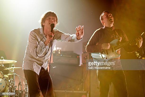Matthew Shultz and Brad Shultz of Cage The Elephant performs on stage at Manchester Apollo on February 7 2014 in Manchester United Kingdom