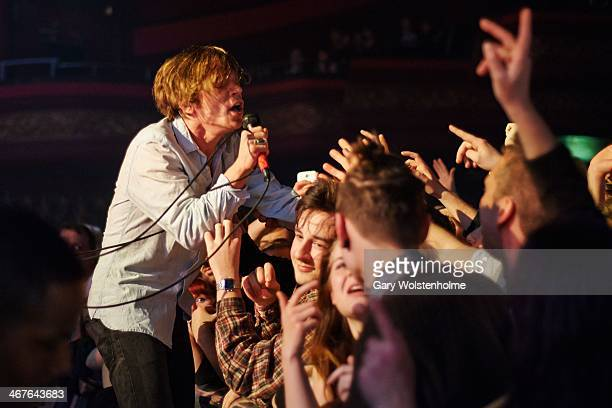 Matthew Shultz of Cage The Elephant performs on stage at Manchester Apollo on February 7 2014 in Manchester United Kingdom