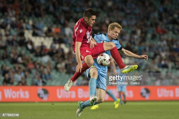 Matthew Simon of Sydney FC challenges Adelaide's Benjamin Warland during the FFA Cup Final match between Sydney FC and Adelaide United at Allianz...