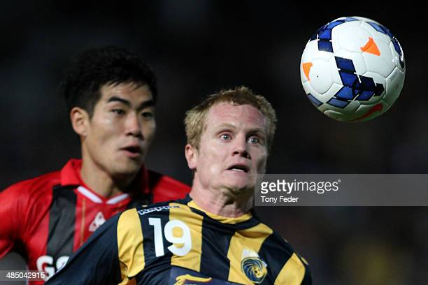 Matthew Simon of the Mariners contests the ball with Kim Ju Young of FC Seoul during the AFC Asian Champions League match between the Central Coast...