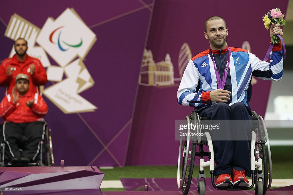 Matthew Skelhon of Great Britain celebrates winning a Bronze Medal after competing in the mixed R6-50m Rifle Prone- SH1 final round on day 6 of the London 2012 Paralympic Games at The Royal Artillery Barracks on September 4, 2012 in London, England.