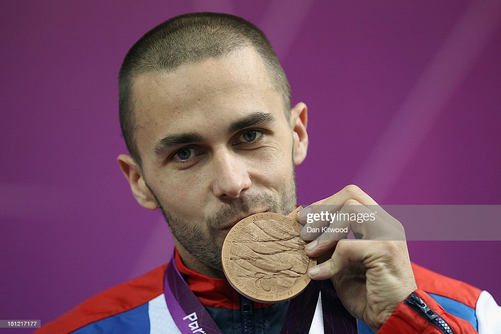 Matthew Skelhon of Great Britain poses with his Bronze medal after competing in the mixed R6-50m Rifle Prone- SH1 final round on day 6 of the London 2012 Paralympic Games at The Royal Artillery Barracks on September 4, 2012 in London, England.