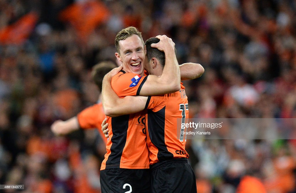 Matthew Smith and Matthew McKay celebrate victory as the full time siren sounds the 2014 A-League Grand Final match between the Brisbane Roar and the Western Sydney Wanderers at Suncorp Stadium on May 4, 2014 in Brisbane, Australia.