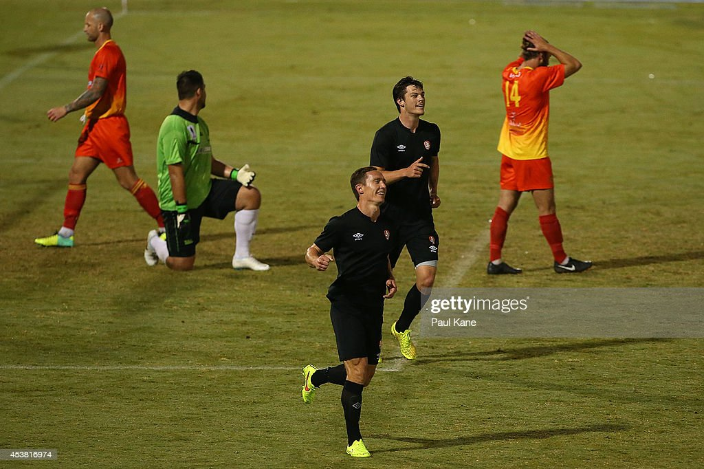 Matthew Smith of the Roar celebrates a goal during the FFA Cup match between the Stirling Lions and the Brisbane Roar at Western Australia Athletics Stadium on August 19, 2014 in Perth, Australia.