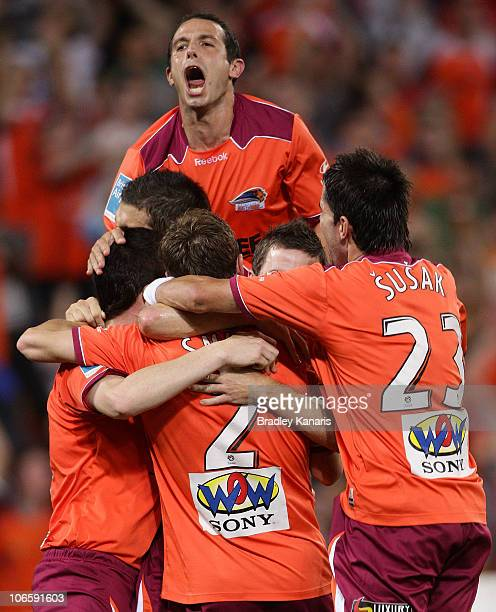 Matthew Smith of the Roar celebrates with team mates after scoring a goal during the round 13 ALeague match between the Brisbane Roar and Adelaide...