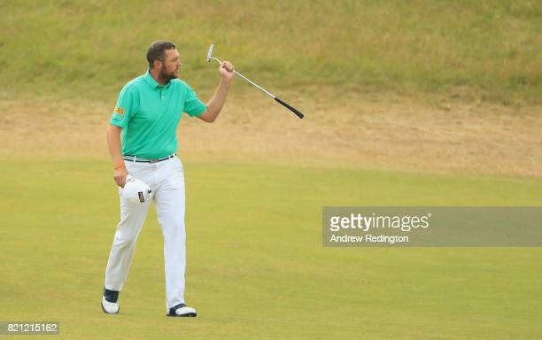 Matthew Southgate of England waves to the galleries on the 18th fairway during the final round of the 146th Open Championship at Royal Birkdale on...