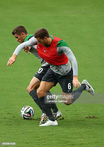Matthew Spiranovic of the Socceroos contests the ball with Dario Vidosic of the Socceroos during an Australian Socceroos training session and press...