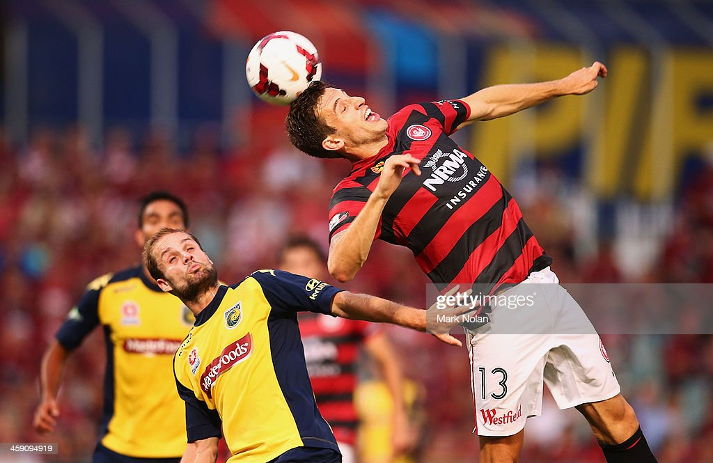 Matthew Spiranovic of the Wanderers and Marcel Seip of the Mariners contest possession during the round 11 A-League match between the Western Sydney Wanderers and the Central Coast Mariners at Parramatta Stadium on December 23, 2013 in Sydney, Australia.