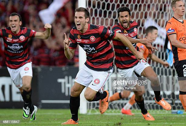 Matthew Spiranovic of the Wanderers celebrates after scoring a goal during the 2014 ALeague Grand Final match between the Brisbane Roar and the...