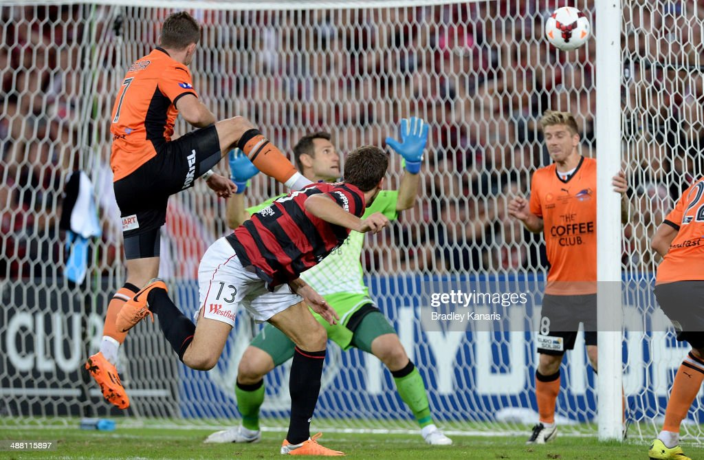 Matthew Spiranovic of the Wanderers heads the ball in to score a goal during the 2014 ALeague Grand Final match between the Brisbane Roar and the...