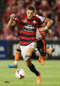 Matthew Spiranovic of the Wanderers is challenged by Besart Berisha of the Roar during the round 18 ALeague match between the Western Sydney...