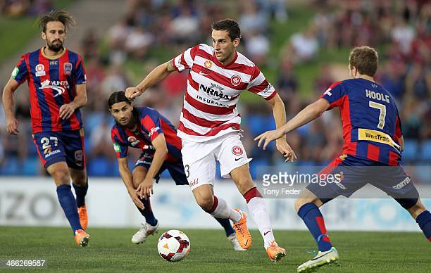Matthew Spiranovic of the Wanderers weaves his way through the Jets defence during the round 17 ALeague match between Newcastle Jets and the Western...