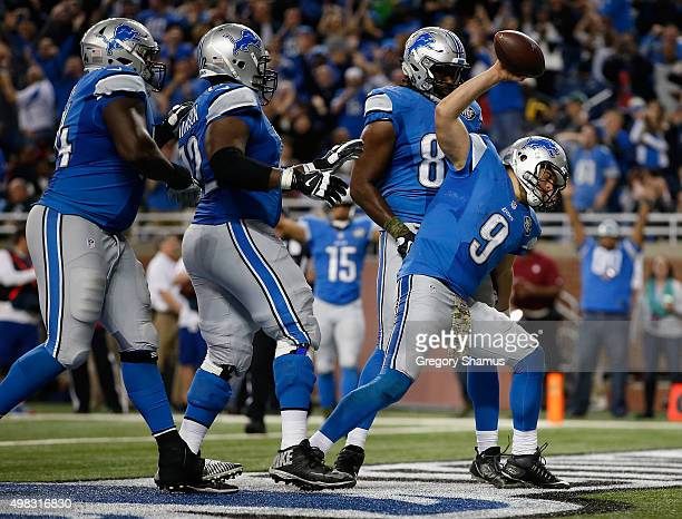 Matthew Stafford of the Detroit Lions celebrates his fourth quarter touchdown agains the Oakland Raiders at Ford Field on November 22 2015 in Detroit...