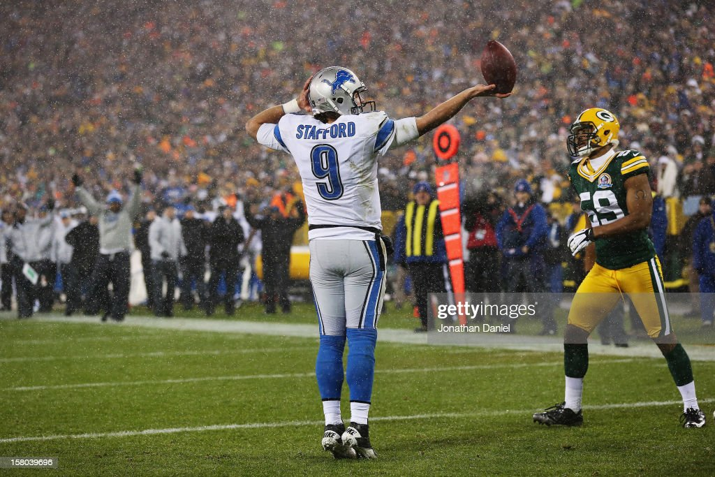 Matthew Stafford #9 of the Detroit Lions celebrates in the end zone after scoring against the Green Bay Packers at Lambeau Field on December 9, 2012 in Green Bay, Wisconsin.