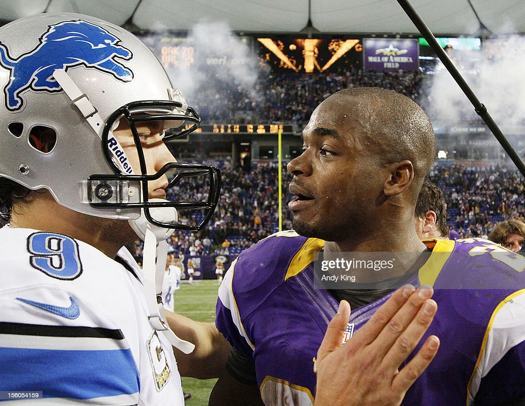 Matthew Stafford #9 of the Detroit Lions congratulates Adrian Peterson #28 of the Minnesota Vikings after their game on November 11, 2012 at Mall of America Field at the Hubert H. Humphrey Metrodome in Minneapolis, Minnesota. The Vikings defeated the Lions 34-24.