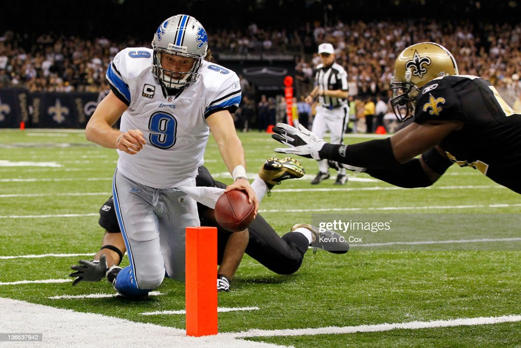 Matthew Stafford of the Detroit Lions dives for the touchdown against Roman Harper and Will Smith of the New Orleans Saints during their 2012 NFC...