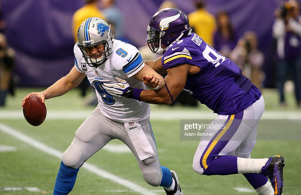 Matthew Stafford #9 of the Detroit Lions gets sacked by Everson Griffen #97 of the Minnesota Vikings on December 29, 2013 at Mall of America Field at the Hubert H. Humphrey Metrodome in Minneapolis, Minnesota.
