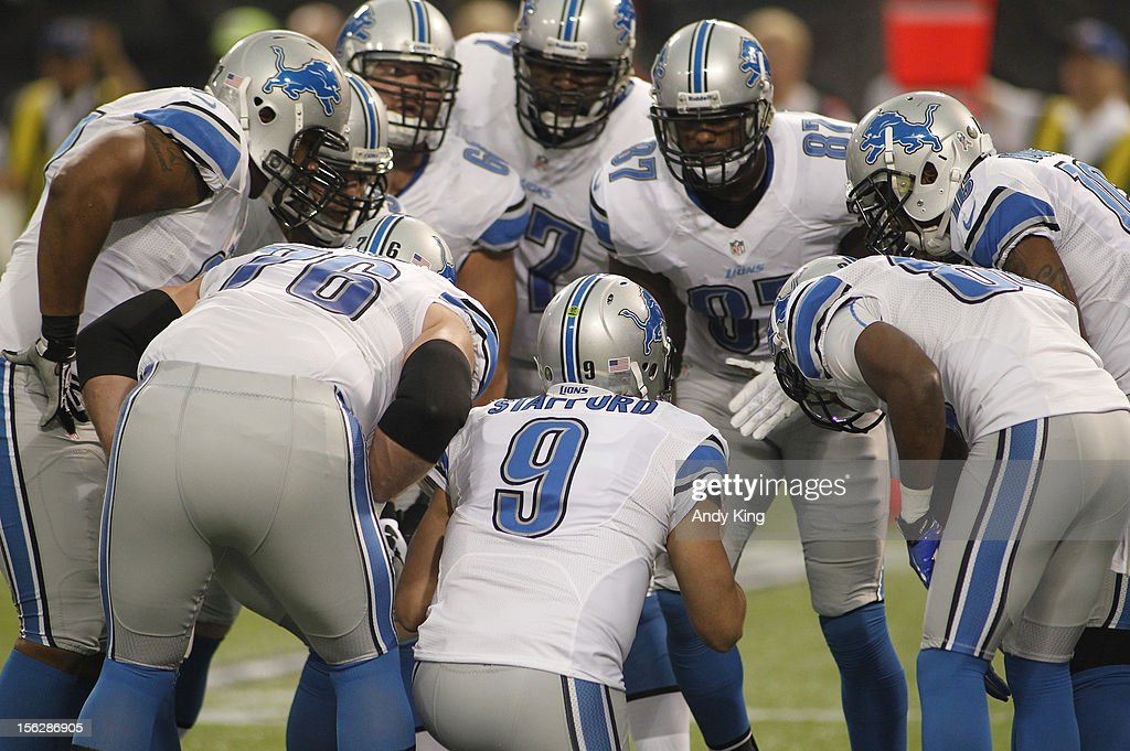 Matthew Stafford #9 of the Detroit Lions huddles with his team against the Minnesota Vikings on November 11, 2012 at Mall of America Field at the Hubert H. Humphrey Metrodome in Minneapolis, Minnesota.