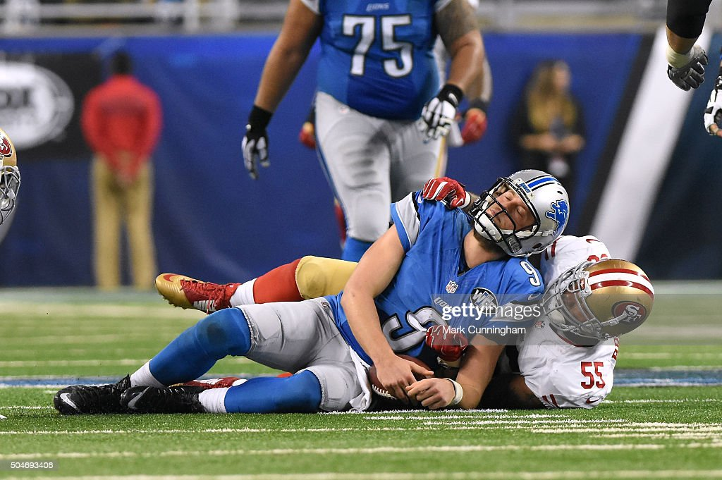 Matthew Stafford #9 (center) of the Detroit Lions is sacked Ahmad Brooks #55 of the San Francisco 49ers during the game at Ford Field on December 27, 2015 in Detroit, Michigan. The Lions defeated the 49ers 32-17.