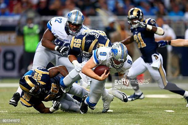Matthew Stafford of the Detroit Lions is sacked by Aaron Donald of the St Louis Rams in the fourth quarter at the Edward Jones Dome on December 13...