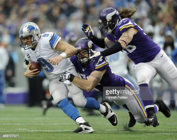 Matthew Stafford of the Detroit Lions is sacked by Jared Allen and Brian Robison of the Minnesota Vikings during the first quarter of the game on...