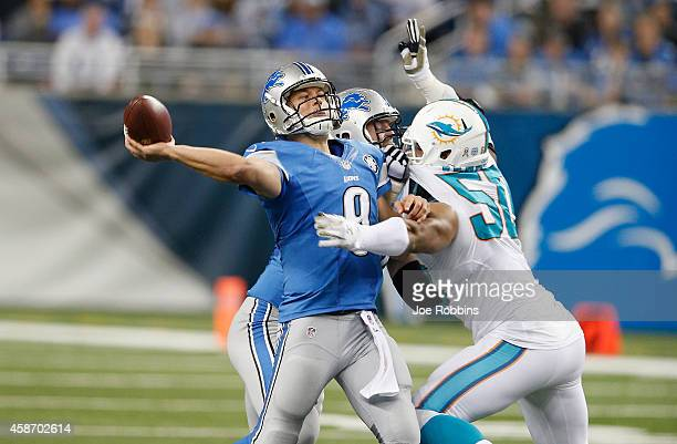 Matthew Stafford of the Detroit Lions is sacked by Olivier Vernon of the Miami Dolphins in the third quarter at Ford Field on November 09 2014 in...