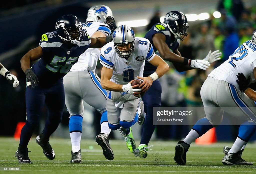 Matthew Stafford #9 of the Detroit Lions is tackled by Cliff Avril #56 of the Seattle Seahawks during the second half of the NFC Wild Card game at CenturyLink Field on January 7, 2017 in Seattle, Washington.