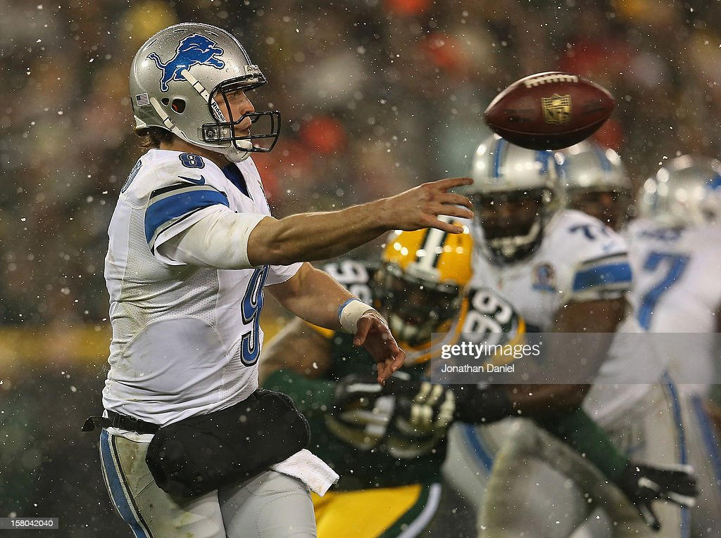 Matthew Stafford #9 of the Detroit Lions passes against the Green Bay Packers at Lambeau Field on December 9, 2012 in Green Bay, Wisconsin.