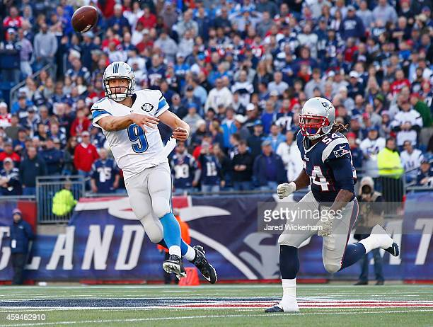 Matthew Stafford of the Detroit Lions passes the ball as Dont'a Hightower of the New England Patriots rushes him during the second quarter at...