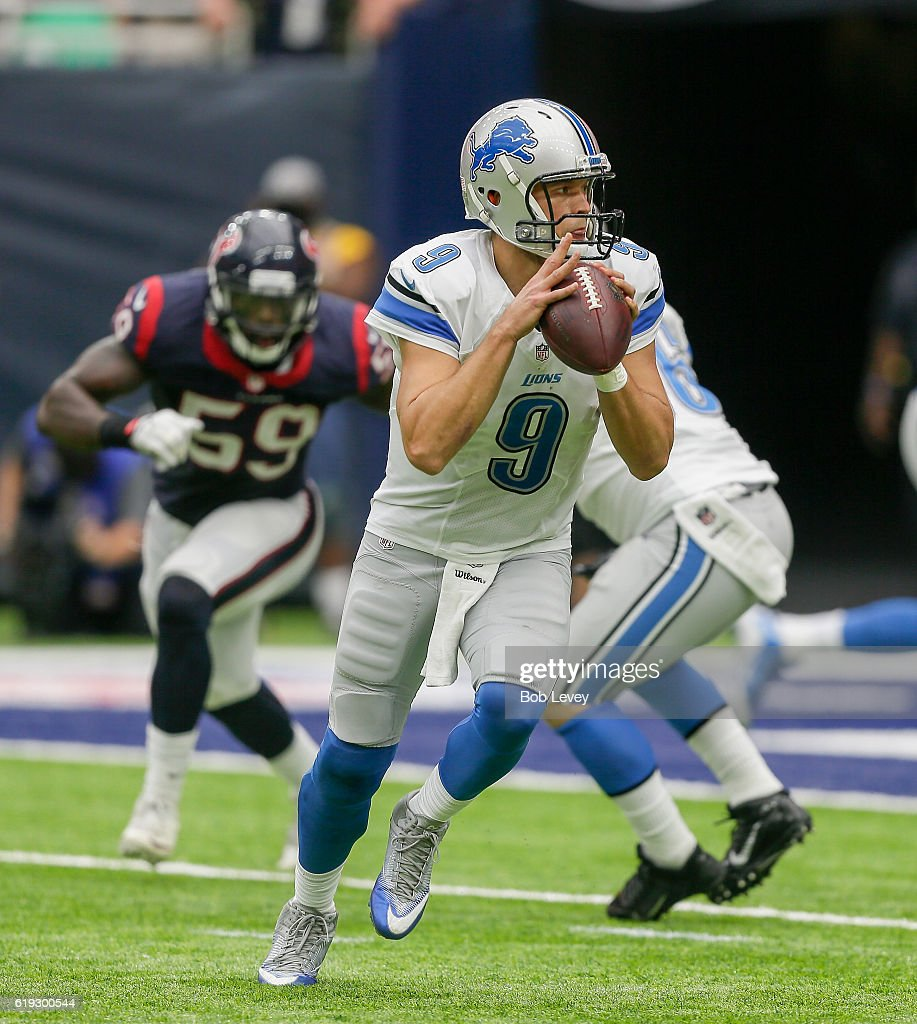 Matthew Stafford #9 of the Detroit Lions rolls out looking for a receiver against the Houston Texans at NRG Stadium on October 30, 2016 in Houston, Texas.