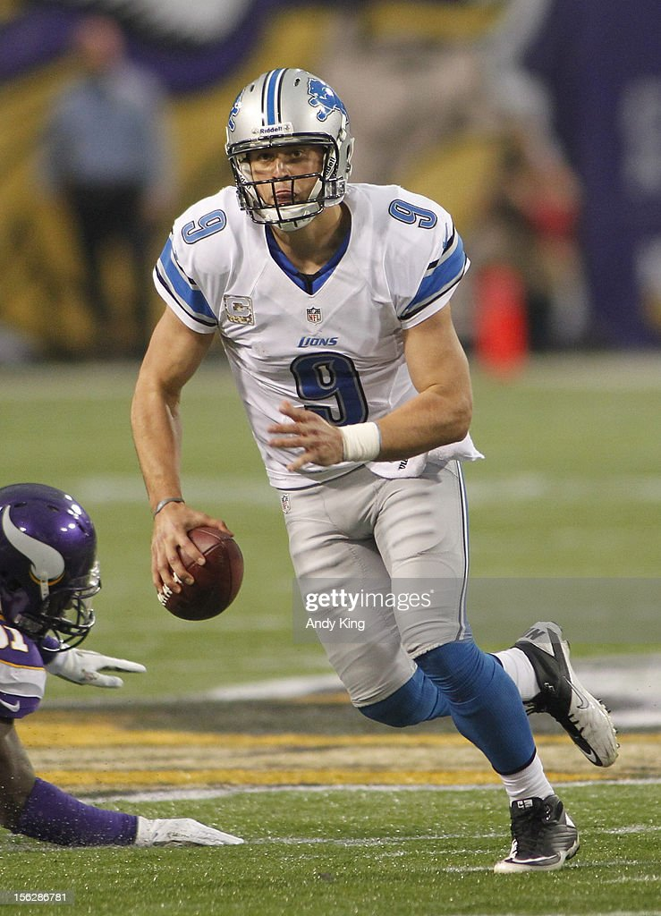 Matthew Stafford #9 of the Detroit Lions scrambles against the Minnesota Vikings on November 11, 2012 at Mall of America Field at the Hubert H. Humphrey Metrodome in Minneapolis, Minnesota.