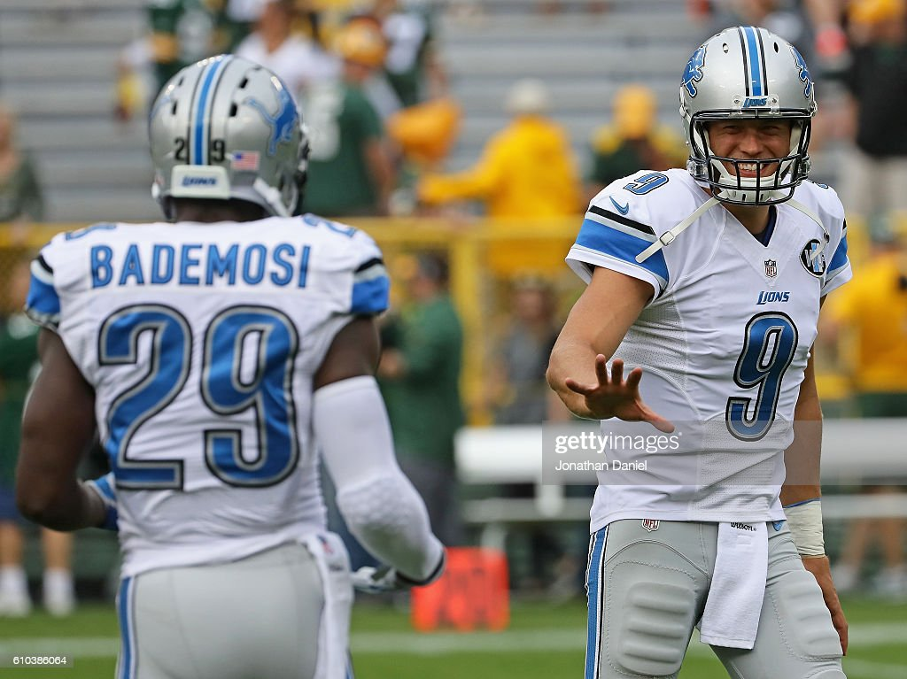 ... Matthew Stafford 9 of the Detroit Lions shares a laugh with Johnson  Bademosi 29 ... aaa77e1bb