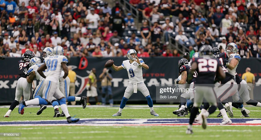 Matthew Stafford #9 of the Detroit Lions sits in the pocjet as he looks for a receiver against the Houston Texans at NRG Stadium on October 30, 2016 in Houston, Texas.