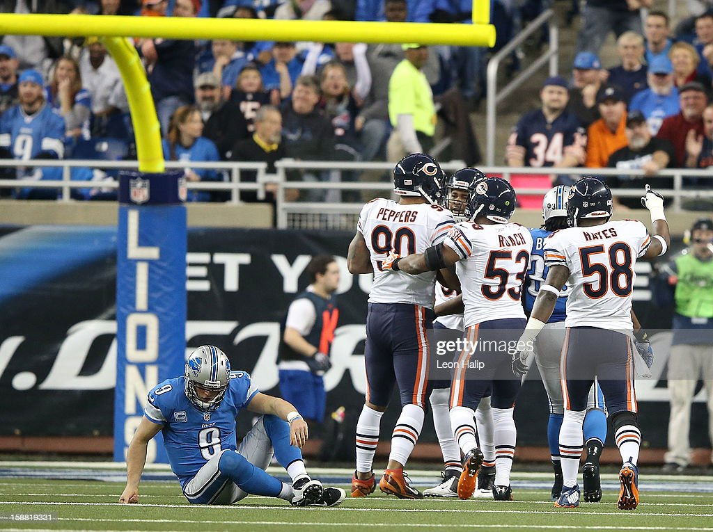 Matthew Stafford #9 of the Detroit Lions sits on the ground after fumbling the ball on the nine yard line during the third quarter of the game against the Chicago Bears at Ford Field on December 30, 2012 in Detroit, Michigan. The Bears defeted the Lions 26-24.