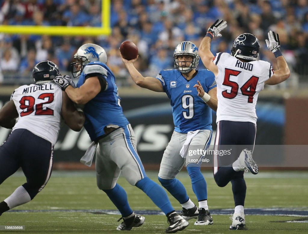 Matthew Stafford #9 of the Detroit Lions throws a pass as Barrett Ruud #54 of the Houston Texans attempts to block the pass during the game at Ford Field on November 22, 2012 in Detroit, Michigan. The Texans defeated the Lions 34-31.