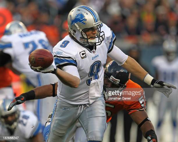 Matthew Stafford of the Detroit Lions throws an incomplete pass as he is tackled by Lance Briggs of the Chicago Bears at Soldier Field on November 13...
